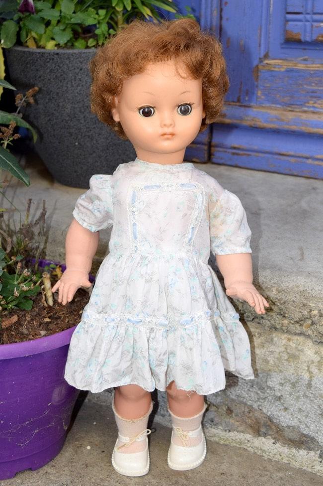 poupée Bella marcheuse à palonnier